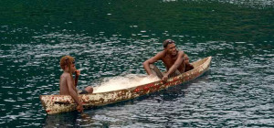 Two fishermen in a canoe, Solomon Islands